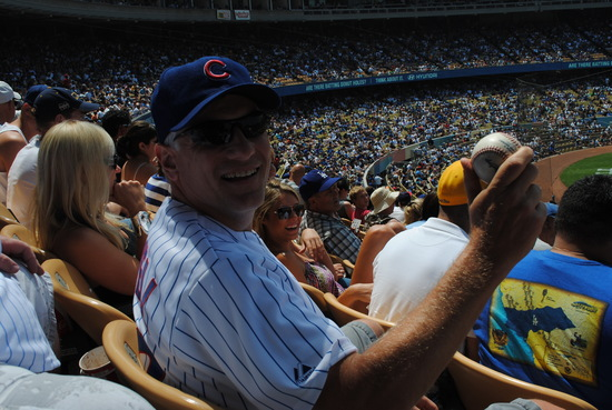 Fan in LA with Foul Ball Souvenir